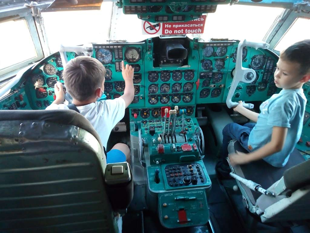 Boys in real IL-62 cockpit